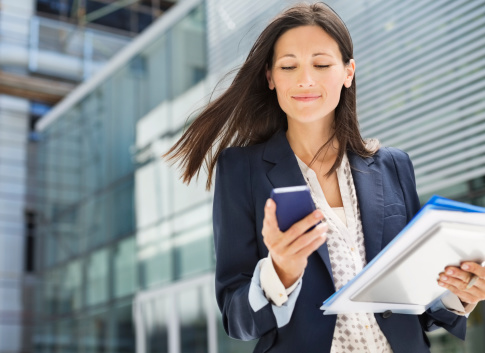 business-woman using mobile phone
