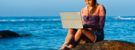pexels-photo-woman-with-laptop-beach
